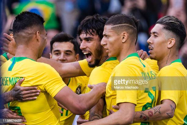 Lucas Lima of Brazil celebrates his goal with his teammates during the International Friendly Match between Brazil and Panama at Estadio do Dragao on...
