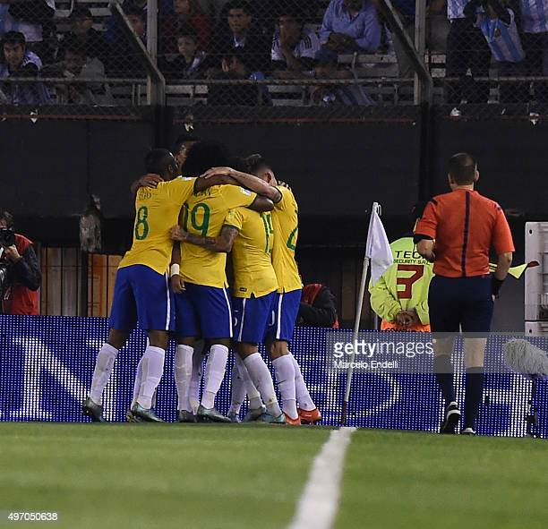 Lucas Lima of Brazil celebrates with teammates after scoring the first goal of his team during a match between Argentina and Brazil as part of FIFA...