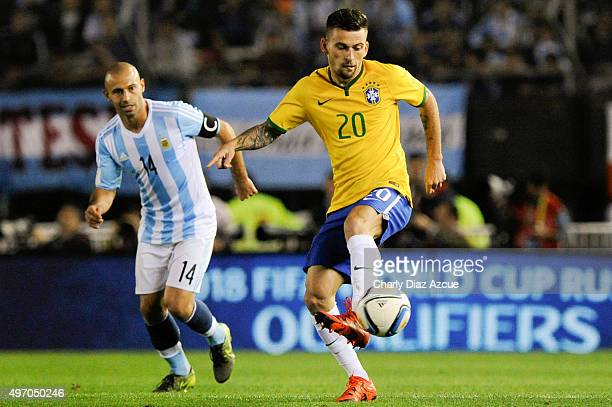 Lucas Lima of Brazil struggles for the ball with Javier Mascherano of Argentina during a match between Argentina and Brazil as part of FIFA 2018...