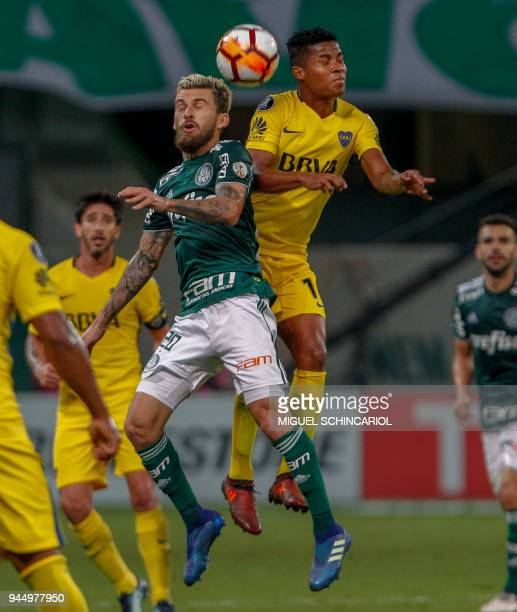 Lucas Lima of Brazil's Palmeiras jumps for a header with Colombian Wilmar Barrios of Argentina's Boca Juniors during their 2018 Copa Libertadores...