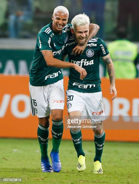 Lucas Lima of Palmeiras celebrates with teammate Deyverson after scoring the second goal of his team during the match against Botafogo for the...