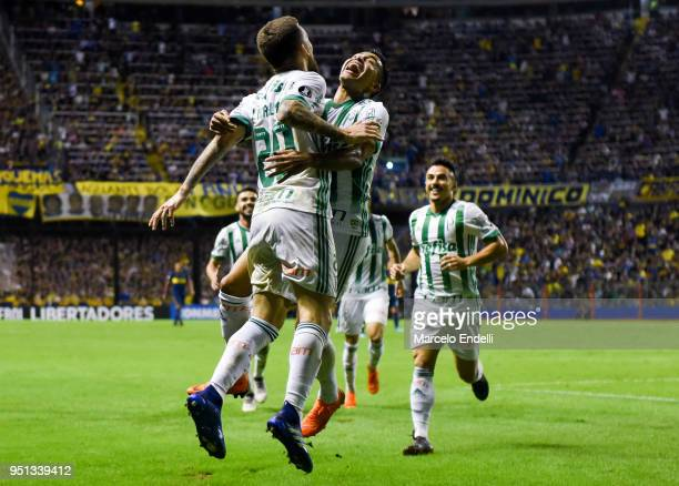 Lucas Lima of Palmeiras celebrates with teammates after scoring the second goal of his team during a match between Boca Juniors and Palmeiras as part...