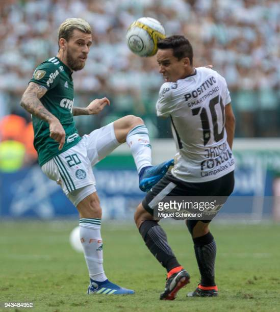 Lucas Lima of Palmeiras vies for the ball with Jadson of Corinthians during a match between Palmeiras and Corinthians in the final of Paulista...