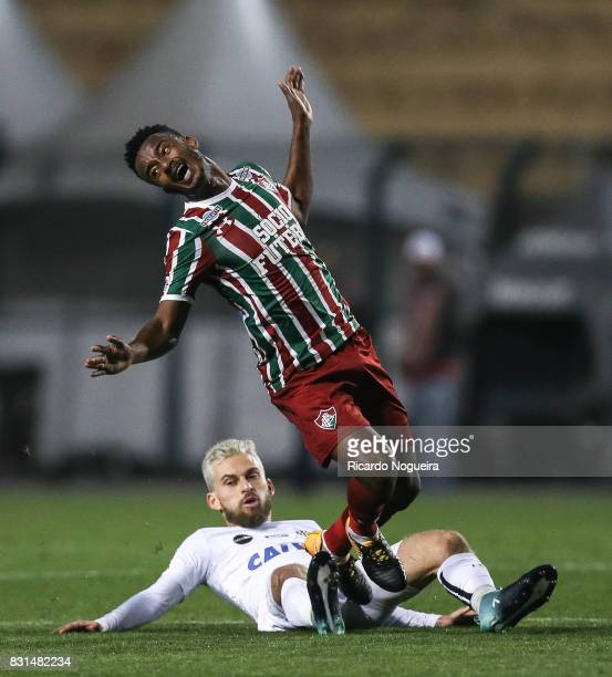Lucas Lima of Santos battles for the ball with Leo 15# of Fluminense during the match between Santos and Fluminense as a part of Campeonato...