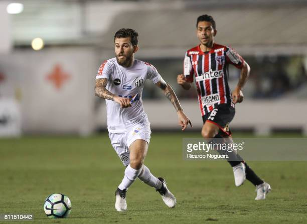 Lucas Lima of Santos battles for the ball with Petros of Sao Paulo during the match between Santos and Sao Paulo as a part of Campeonato Brasileiro...