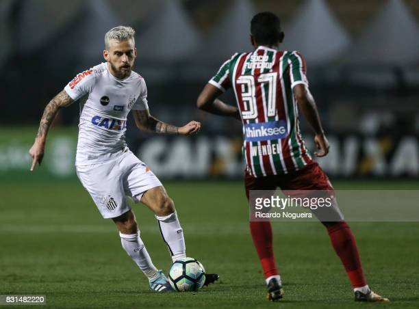 Lucas Lima of Santos battles for the ball with Wendel of Fluminense during the match between Santos and Fluminense as a part of Campeonato Brasileiro...