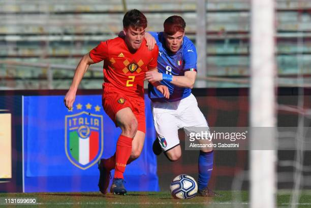 Lucas Lissens of Belgium U19 competes for the ball with Lorenzo Gavioli of Italy U19 during the UEFA Elite Round match between Italy U19 and Belgium...