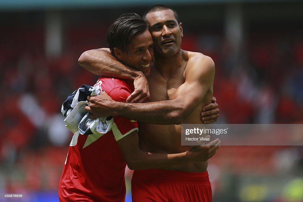 Lucas Lobos and Paulo Da Silva of Toluca celebrate after winning the match between Toluca and Monterrey as part of 9th round Apertura 2014 Liga MX at Nemesio Diez Stadium on September 21, 2014 in Toluca, Mexico.