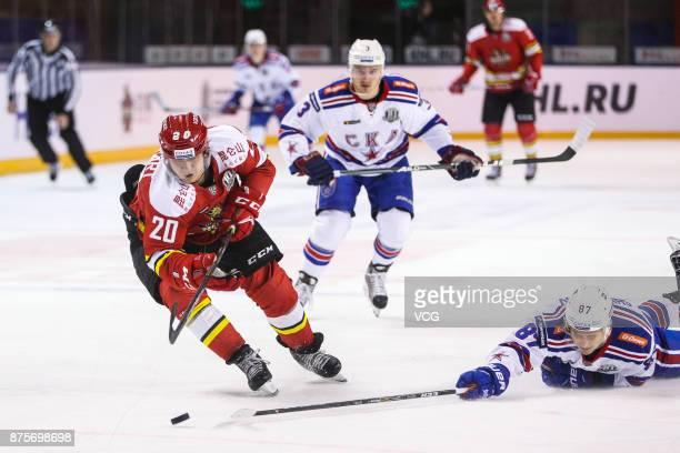 Lucas Lockhart of HC Kunlun Red Star and Dinar Khafizullin of SKA Saint Petersburg vie for the puck during the 2017/18 Kontinental Hockey League...