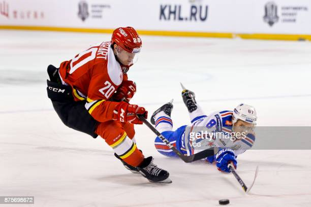 Lucas Lockhart of HC Kunlun Red Star and Vadim Shipachyov of SKA Saint Petersburg vie for the puck during the 2017/18 Kontinental Hockey League...