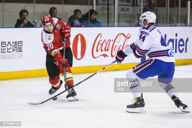 Lucas Lockhart of HC Kunlun Red Star and Yegor Yakovlev of SKA Saint Petersburg vie for the puck during the 2017/18 Kontinental Hockey League Regular...