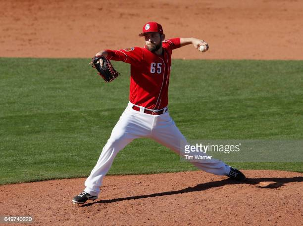 Lucas Luetge of the Cincinnati Reds pitches in the eighth inning against the Los Angeles Angels during the spring training game at Goodyear Ballpark...