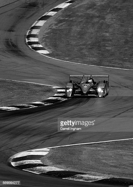 Lucas Luhr drives the LMP1Audi Sport North America Audi R10TDI during practice for the American Le Mans Series Petit Le Mans on October 2, 2008 at...