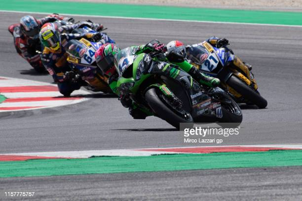 Lucas Mahias of France and Kawasaki Puccetti Racing leads the field during the Tissot Superpole race during the FIM Superbike World Championship in...