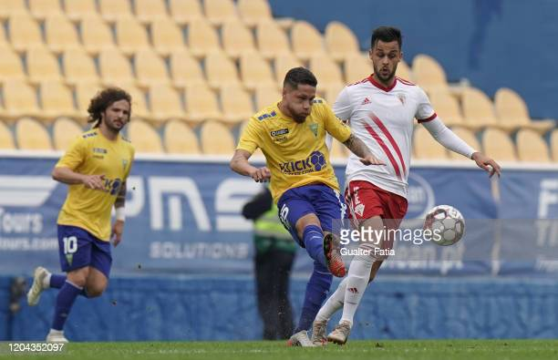 Lucas Marques of GD Estoril Praia with Filipe Oliveira of UD Vilafranquense in action during the Liga Pro match between GD Estoril Praia and UD...
