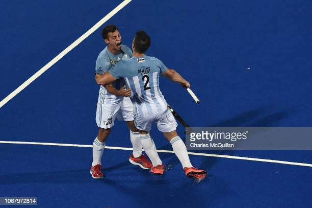 Lucas Martinez of Argentina celebrates with Gonzalo Peillat of Argentina during the FIH Men's Hockey World Cup Pool A match between New Zealand and...