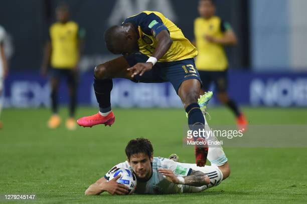 Lucas Martinez Quarta of Argentina fights for the ball with Enner Valencia of Ecuador during a match between Argentina and Ecuador as part of South...