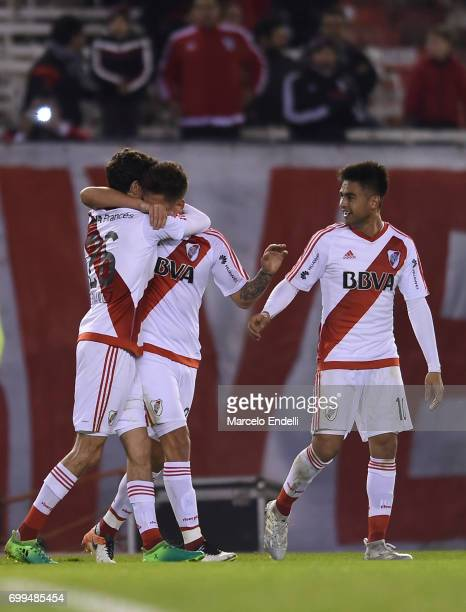 Lucas Martinez Quarta of River Plate celebrates with teammates Ignacio Fernandez and Gonzalo Martinez after scoring the first goal of his team during...