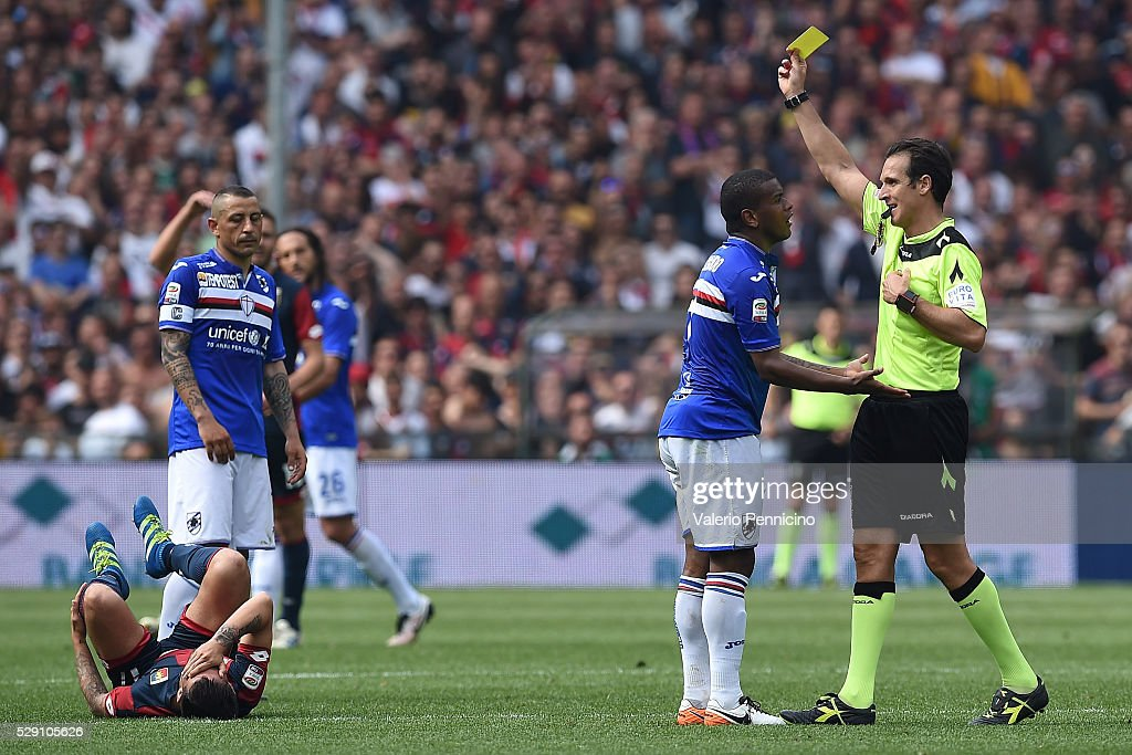 Lucas Martins Fernando (C) of UC Sampdoria receives the yellow card from referee Luca Banti during the Serie A match between UC Sampdoria and Genoa CFC at Stadio Luigi Ferraris on May 8, 2016 in Genoa, Italy.