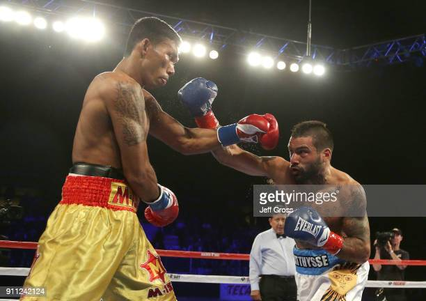 Lucas Matthysse of Argentina throws a right hand at Tewa Kiram of Thailand during their bout at The Forum on January 27 2018 in Inglewood California