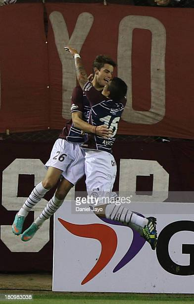 Lucas Melano of Argentina's Lanus celebrates with teammate Hugo Ayala after scoring during a match between Lanus and U de Chile as part of Copa Total...