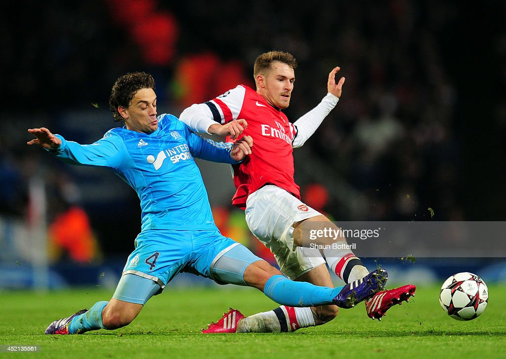Lucas Mendes of Marseille and Aaron Ramsey of Arsenal battle for the ball during the UEFA Champions League Group F match between Arsenal and Olympique de Marseille at Emirates Stadium on November 26, 2013 in London, England.