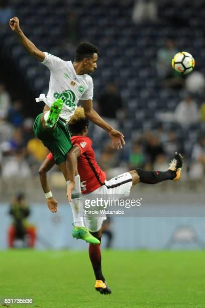 Lucas Mineiro of Chapecoense and Ado Onaiwu of Urawa Red Diamonds compete for the ball during the Suruga Bank Championship match between Urawa Red...