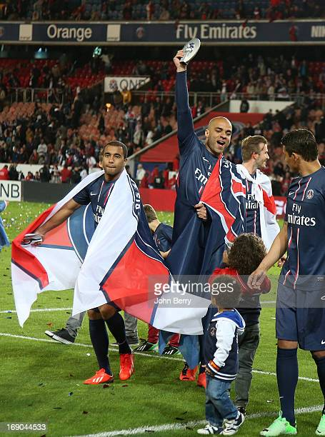Lucas Moura and Alex Dias Da Costa of PSG celebrate PSG's french championship title during the trophy ceremony after the Ligue 1 match between Paris...