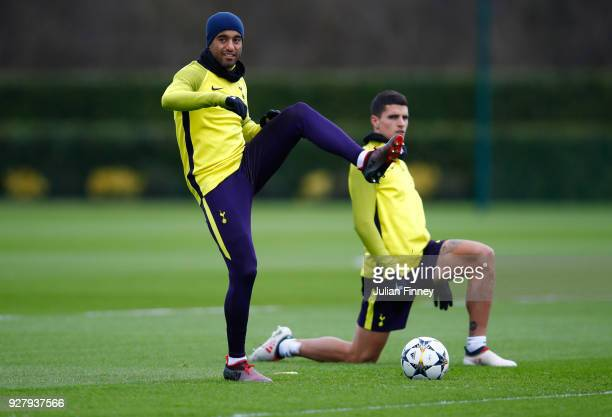Lucas Moura and Erik Lamela warm up during a Tottenham Hotspur training session on the eve of their UEFA Champions League match against Juventus at...