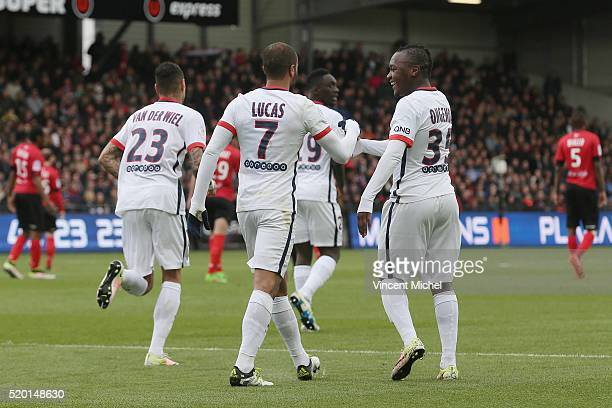 Lucas Moura and Hervin Ongenda of Paris SaintGermain during the French League 1 match between EA Guingamp and Paris SaintGermain on April 9 2016 in...