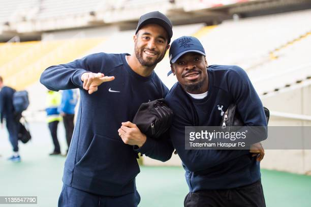 Lucas Moura and Serge Aurier of Tottenham Hotspur pose for a photo before a training session on March 13 2019 at Estadi Olimpic Lluis Companys in...