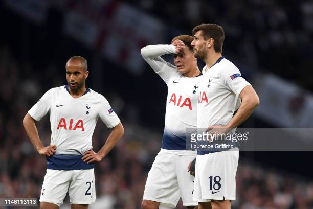 Lucas Moura Dele Alli and Fernando Llorente of Tottenham Hotspur look despondent during the UEFA Champions League Semi Final first leg match between...