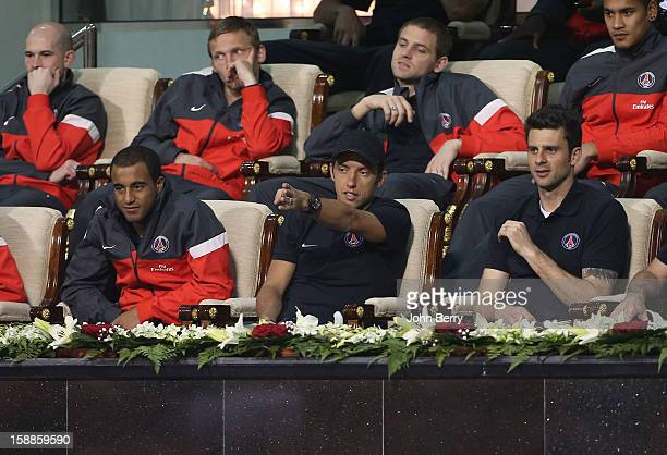 Lucas Moura Nene Thiago Motta of PSG watch David Ferrer of Spain against Dustin Brown of Germany during their first round match on day two of the...