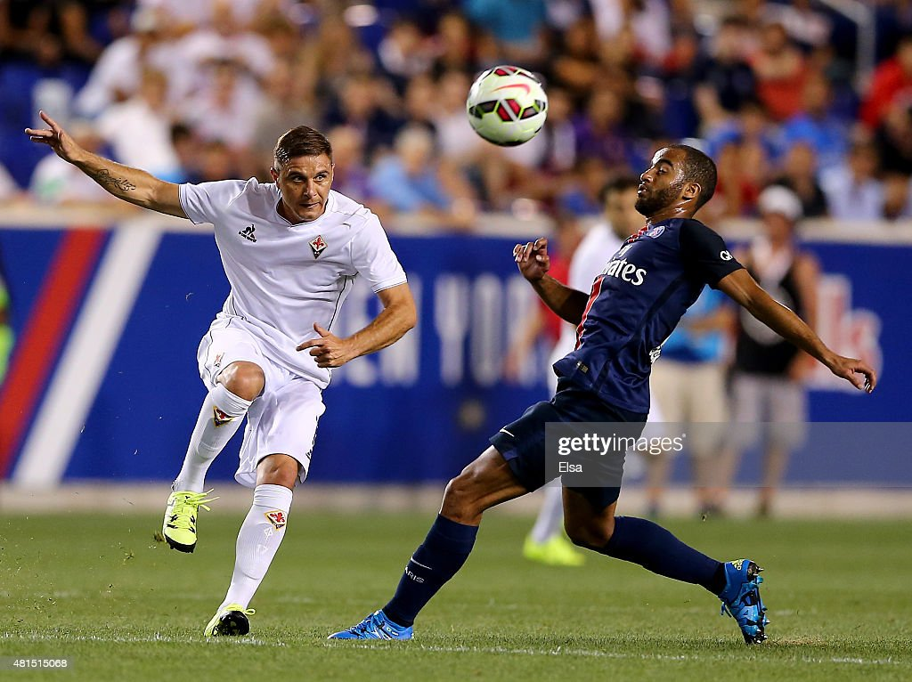 Lucas Moura #7 of Paris Saint-Germain and Joaquin Sanchez #7 of AFC Fiorentina fight for the ball during the International Champions Cup at Red Bull Arena on July 21, 2015 in Harrison, New Jersey.Paris Saint-Germain defeated ACF Fiorentina 4-2.