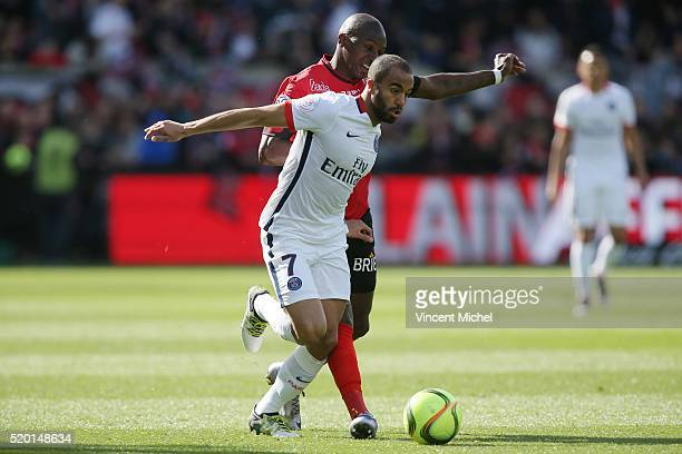 Lucas Moura of Paris SaintGermain and Younousse Sankhare of Guingamp during the French League 1 match between EA Guingamp and Paris SaintGermain on...