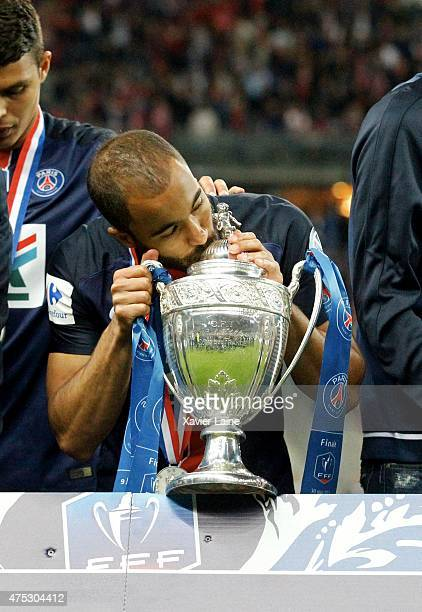 Lucas Moura of Paris SaintGermain kiss the cup after the French Cup Final between AJ Auxerre and Paris SaintGermain FC at Stade de France on may 30...