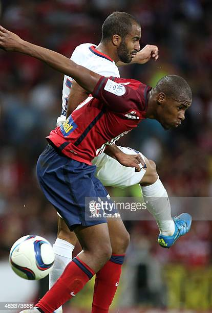 Lucas Moura of PSG and Djibril Sidibe of Lille in action during the French Ligue 1 match between Lille OSC and Paris SaintGermain at Grand Stade...