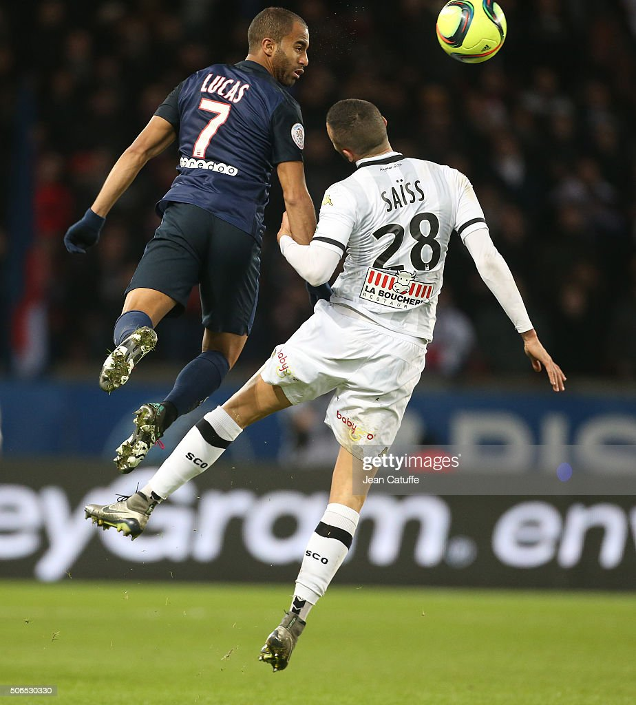 Lucas Moura Of PSG And Romain Saiss Of Angers In Action