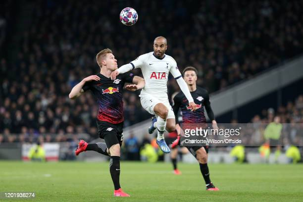 Lucas Moura of Spurs battles with Marcel Halstenberg of RB Leipzig and Ethan Ampadu of RB Leipzig during the UEFA Champions League round of 16 first...