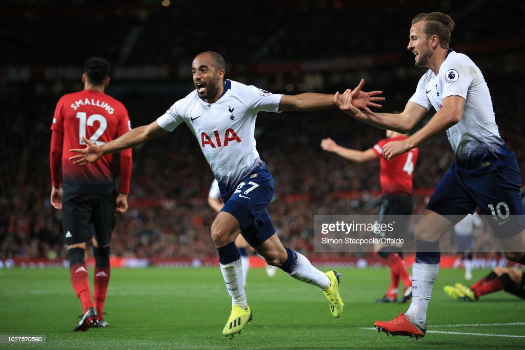 Lucas Moura of Spurs celebrates with teammate Harry Kane after scoring their 2nd goal during the Premier League match between Manchester United and Tottenham Hotspur at Old Trafford on August 27, 2018 in Manchester, England.