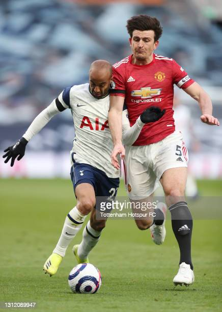 Lucas Moura of Tottenham Hotspur and Harry Maguire of Manchester United during the Premier League match between Tottenham Hotspur and Manchester...