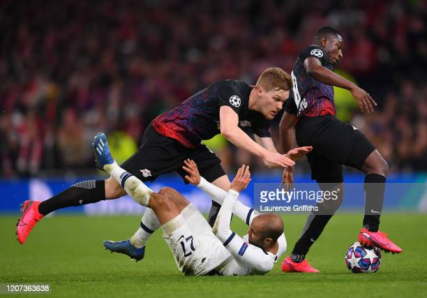 Lucas Moura of Tottenham Hotspur and Marcel Halstenberg and Amadou Haidara of RB Leipzig during the UEFA Champions League round of 16 first leg match...