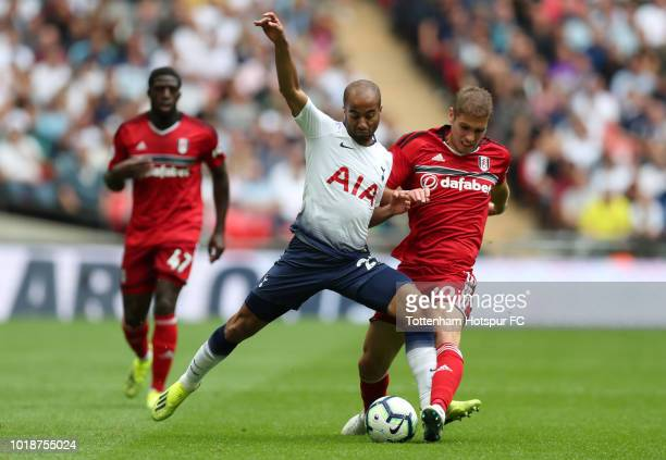 Lucas Moura of Tottenham Hotspur and Maxime Le Marchand of Fulham battle for the ball during the Premier League match between Tottenham Hotspur and...