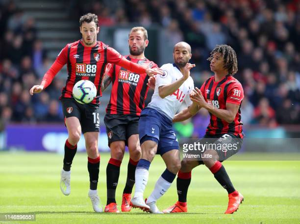 Lucas Moura of Tottenham Hotspur battles for possession with Adam Smith Steve Cook and Nathan Ake of AFC Bournemouth during the Premier League match...
