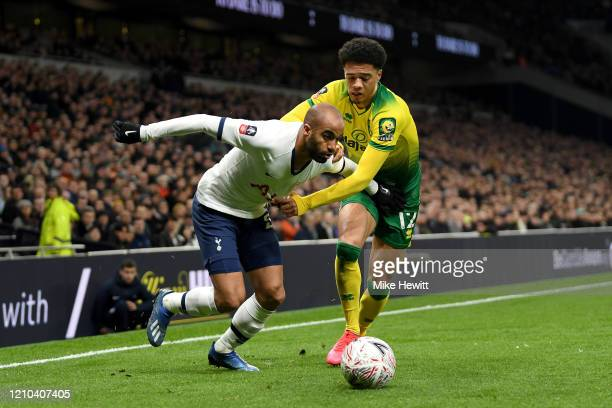 Lucas Moura of Tottenham Hotspur battles for possession with Jamal Lewis of Norwich City during the FA Cup Fifth Round match between Tottenham...