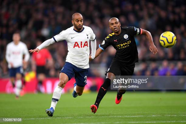 Lucas Moura of Tottenham Hotspur battles for possession with Fernandinho of Manchester City during the Premier League match between Tottenham Hotspur...