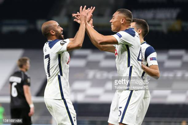 Lucas Moura of Tottenham Hotspur celebrates after scoring his sides first goal with team mate Carlos Vinicius during the UEFA Europa League Group J...