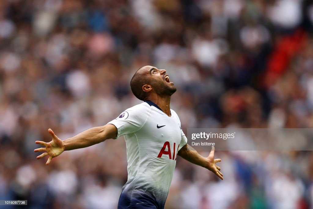 Lucas Moura of Tottenham Hotspur celebrates after scoring his team's first goal during the Premier League match between Tottenham Hotspur and Fulham FC at Wembley Stadium on August 18, 2018 in London, United Kingdom.
