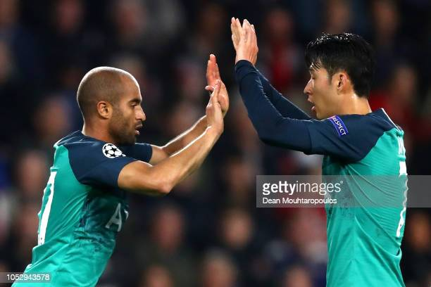 Lucas Moura of Tottenham Hotspur celebrates after scoring his team's first goal with HeungMin Son of Tottenham Hotspur during the Group B match of...