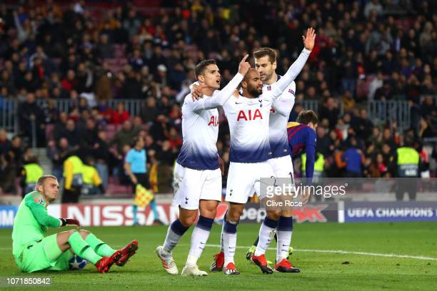 Lucas Moura of Tottenham Hotspur celebrates after scoring his team's first goal with Erik Lamela and Fernando Llorente as Jasper Cillessen of...